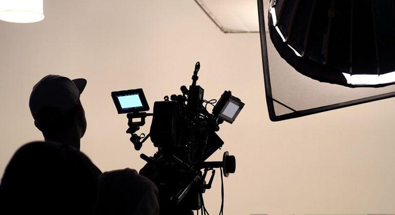 Camera operator on set of video shoot