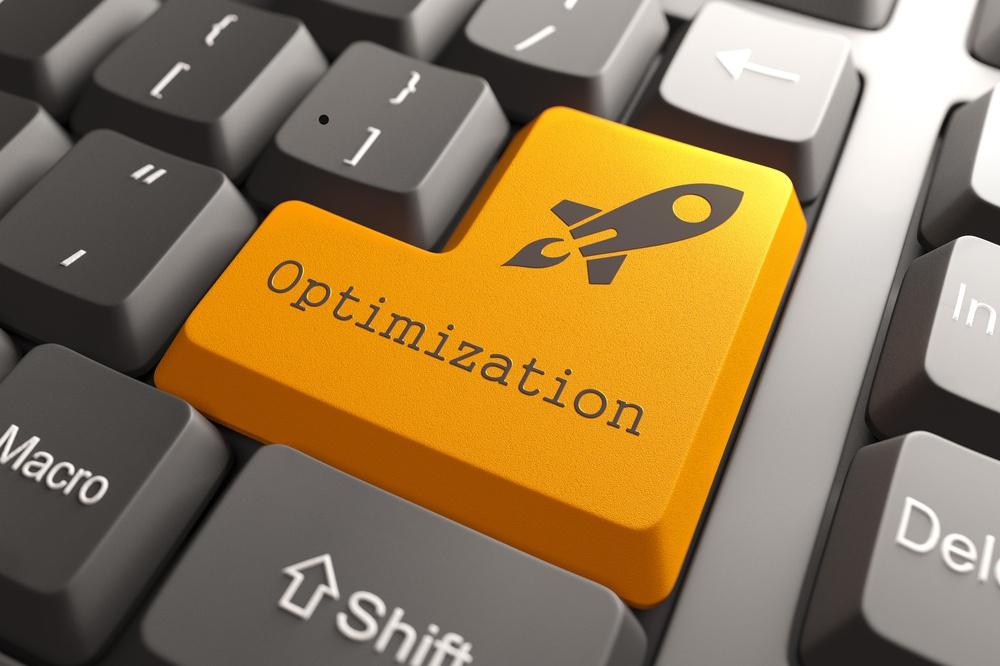 Orange Optimization Button on Computer Keyboard. Business Concept.